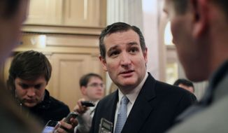 Sen. Ted Cruz, R-Texas, talks with reporters on Capitol Hill in Washington in this Dec. 13, 2014, file photo. (AP Photo/Lauren Victoria Burke, File)
