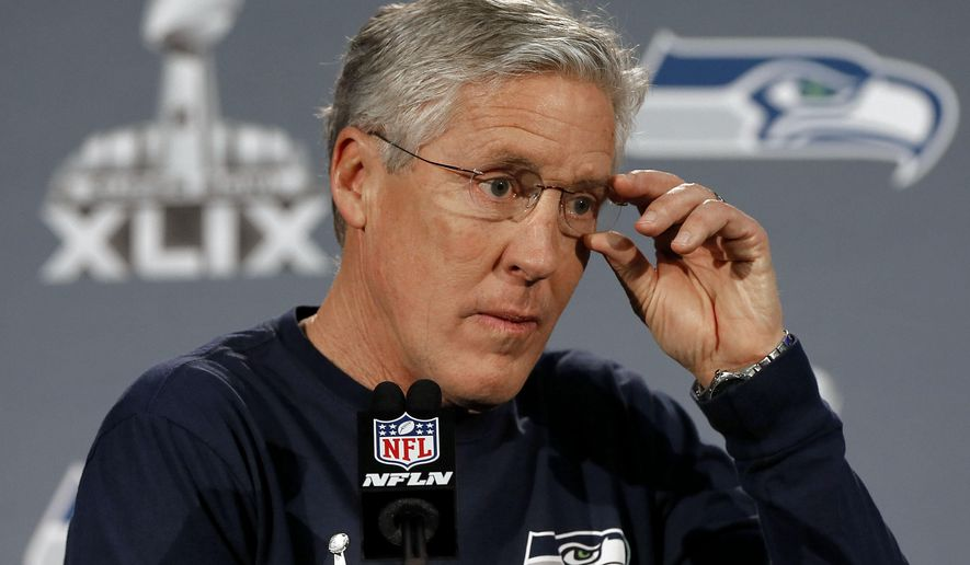 Seattle Seahawks head coach  Pete Carroll answers a question during an interview for NFL Super Bowl XLIX football game, Thursday, Jan. 29, 2015, in Phoenix. The Seahawks play the New England Patriots in Super Bowl XLIX on Sunday, Feb. 1, 2015. (AP Photo/Matt York)