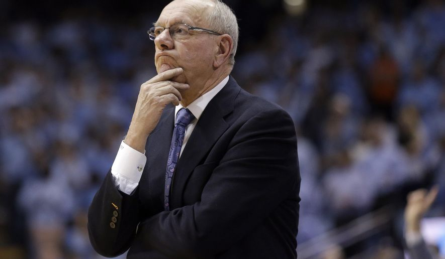 Syracuse coach Jim Boeheim watches in the second half of an NCAA college basketball game against North Carolina in Chapel Hill, N.C., Monday, Jan. 26, 2015. North Carolina won 93-83. (AP Photo/Gerry Broome)