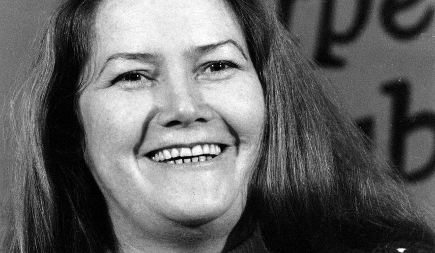 """FILE - In this March 1, 1977 file photo, Australian author Colleen McCullough laughs during a news conference in New York. Best-selling author McCullough, whose novel """"The Thorn Birds"""" sold 30 million copies worldwide, has died at age 77 after a long illness. McCullough died Thursday, Jan. 29, 2015 in hospital on remote Norfolk Island, HarperCollins Australia publishing director Shona Martyn said in a statement. (AP Photo/File)"""