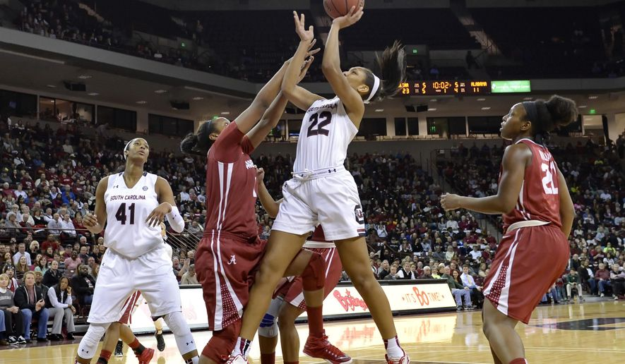 South Carolina's A'ja Wilson shoots while defended by Alabama's Quanetria Bolton, left, and Ashley Williams during the first half of an NCAA college basketball game Thursday, Jan. 29, 2015, in Columbia, S.C.  (AP Photo/Richard Shiro)