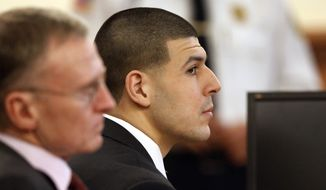 Former New England Patriots football player Aaron Hernandez, right, listens during his murder trial as defense attorney Charles Rankin, left, looks on, Thursday, Jan. 29, 2015, in Fall River, Mass. Hernandez is charged with killing semiprofessional football player Odin Lloyd, 27, in June 2013.  (AP Photo/Steven Senne, Pool)