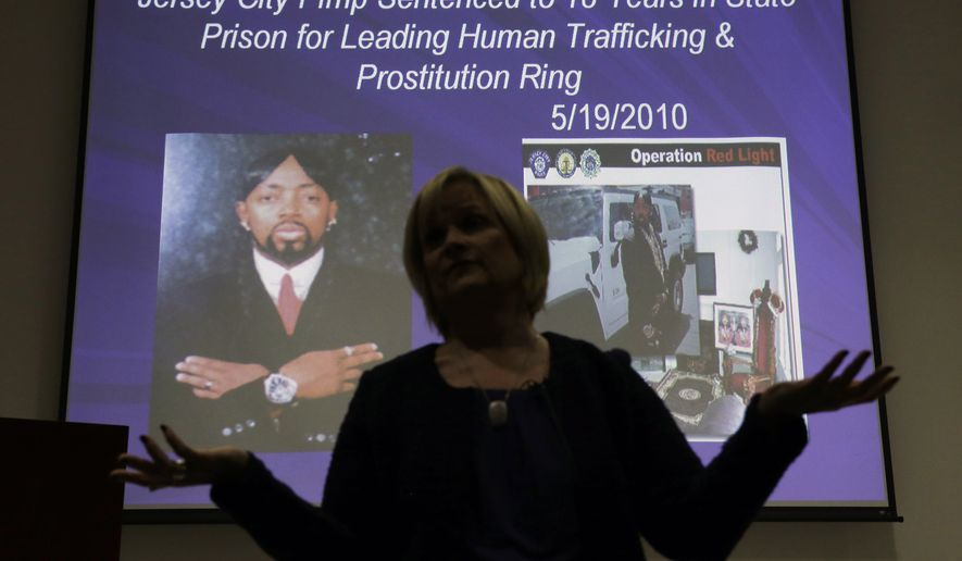 "At the 2014 Super Bowl, legions of law enforcement personnel, hospitality workers, high school students and airport employees were trained to watch for signs of human trafficking before the game. Members of Congress are introducing more bills to curtail the ""modern-day slavery.""  (AP Photo/Mel Evans)"