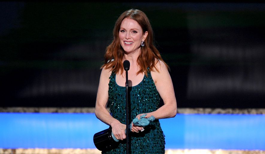 """Julianne Moore accepts the award for outstanding performance by a female actor in a leading role for """"Still Alice"""" at the 21st annual Screen Actors Guild Awards at the Shrine Auditorium on Sunday, Jan. 25, 2015, in Los Angeles. (Photo by Vince Bucci/Invision/AP)"""