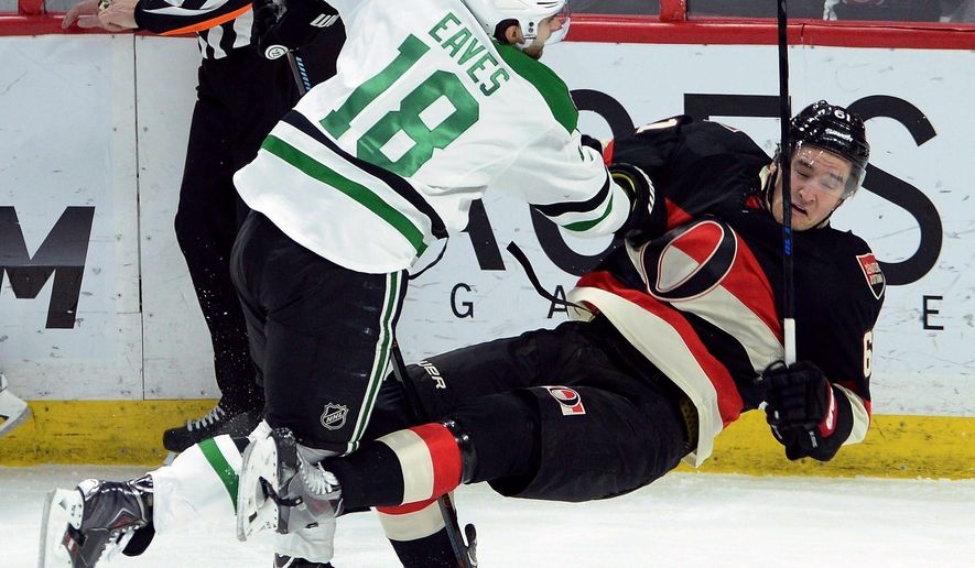 Ottawa Senators' Mark Stone gets hit to the ice by Dallas Stars' Patrick Eaves during the first period on an NHL hockey game, Thursday, Jan. 29, 2015 in Ottawa, Ontario. (AP Photo/Canadian Press, Sean Kilpatrick)