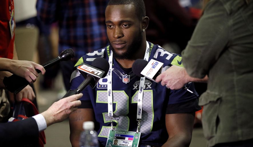 Seattle Seahawks' Kam Chancellor answers a question during an interview for NFL Super Bowl XLIX football game, Thursday, Jan. 29, 2015, in Phoenix. The Seahawks play the New England Patriots in Super Bowl XLIX on Sunday, Feb. 1, 2015. (AP Photo/Matt York)