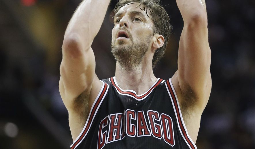 FILE - In this Jan. 19, 2015, file photo Chicago Bulls' Pau Gasol, from Spain, shoots against the Cleveland Cavaliers during an NBA basketball game in Cleveland. Gasol misses the weather, his many friends and the charitable endeavors he left behind in Los Angeles when he signed with the Chicago Bulls last summer. The two-time NBA champion returns to Los Angeles when the Lakers host the Bulls Thursday, Jan. 29. (AP Photo/Mark Duncan, File)