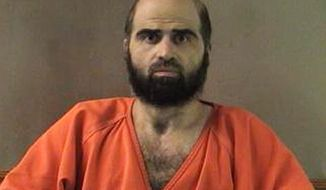 Former Army psychiatrist Maj. Nidal Hasan killed 13 people in a 2009 shooting spree at a Texas Army base. He is on military death row. (AP Photo/Bell County Sheriff's Department, File) ** FILE **