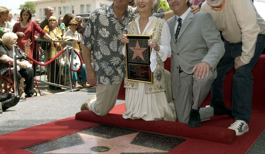 "FILE - In this May 23, 2003 file photo, actress Betty Garrett holds a replica of her new star as she poses with Jeff Bridges, left, Beau Bridges, center, and Rod McKuen, right,  after her star was unveiled on the Hollywood Walk of Fame in Los Angeles. McKuen, the husky-voiced ""King of Kitsch"" whose music and verse recordings won him an Oscar nomination and made him one of the best-selling poets in history, has died on Thursday, Jan. 29, 2015. He was 81.  (AP Photo/Nick Ut, File)"