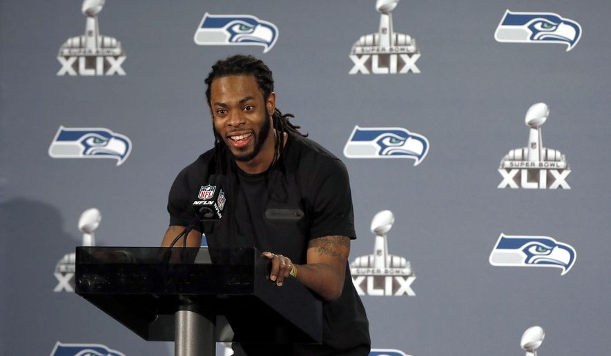 Seattle Seahawks' Richard Sherman answers a question during an interview for NFL Super Bowl XLIX football game, Thursday, Jan. 29, 2015, in Phoenix. The Seahawks play the New England Patriots in Super Bowl XLIX on Sunday, Feb. 1, 2015. (AP Photo/Matt York)