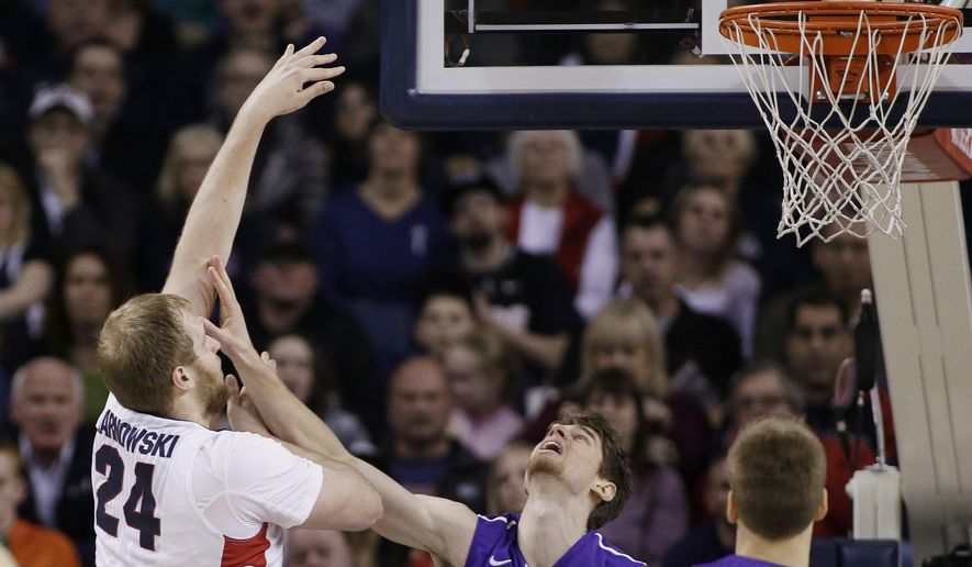 Gonzaga's Przemek Karnowski (24) shoots against Portland's Thomas van der Mars (12) during the first half of an NCAA college basketball game, Thursday, Jan. 29, 2015, in Spokane, Wash. (AP Photo/Young Kwak)