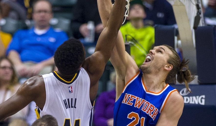 New York Knicks forward Lou Amundson (21) goes up to block the shot of Indiana Pacer's Solomon Hill (44) during the first half of an NBA basketball game, Thursday, Jan. 29, 2015, in Indianapolis. (AP Photo/Doug McSchooler)