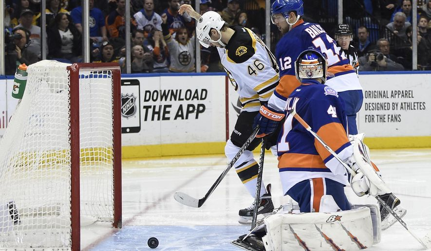 Boston Bruins center David Krejci (46) celebrates a goal by defenseman Torey Krug as New York Islanders left wing Josh Bailey (12) and goalie Jaroslav Halak (41) react during the third period of an NHL hockey game at Nassau Coliseum on Thursday, Jan. 29, 2015, in Uniondale, N.Y. The Bruins won 5-2. (AP Photo/Kathy Kmonicek)