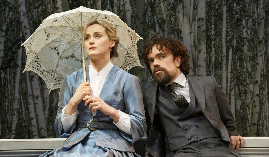 "In this image released by Classic Stage Co., Taylor Schilling, left, and Peter Dinklage perform in a scene from ""A Month in the Country."" (AP Photo/Classic Stage Co., Joan Marcus)"