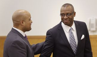 Michael Waithe, right, is congratulated by his attorney, Matthew Smalls, after being exonerated in New York on Thursday, Jan. 29.  A state Supreme Court judge granted a prosecutor's motion to vacate Waithe's 1987 burglary conviction. Brooklyn District Attorney Ken Thompson says in a statement Waithe came to the U.S. seeking a better life but was instead framed for a crime he didn't commit. (Associated Press)