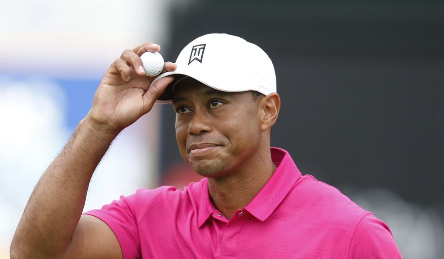 Tiger Woods acknowledges the crowd on the 16th hole during the first round of the Phoenix Open golf tournament, Thursday, Jan. 29, 2015, in Scottsdale, Ariz. (AP Photo/Rick Scuteri)