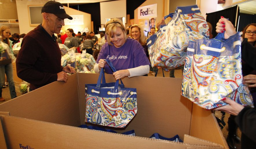 Tony Dungy, Super Bowl winning coach and Pro Football Hall of Fame finalist, seen at the Super Baskets of Hope volunteer event on Monday January 26, 2015 in Phoenix, Arizona. The baskets - filled with games, crafts, toys, books and NFL team merchandise - will be transported by FedEx to more than 20 children's hospitals. (Jason Wise/AP Images for FedEx)
