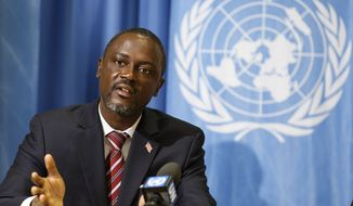 Axel Addy, Minister for Industry and Commerce of Liberia, speaks to the media about the impact of Ebola in his country during a news conference, at the European headquarters of the United Nations in Geneva, Switzerland, Monday, Jan. 26, 2015. (AP Photo/Keystone,Salvatore Di Nolfi)