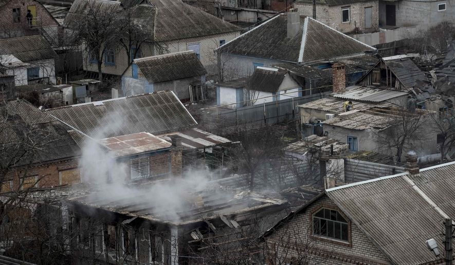 Smoke still rises from a destroyed house that was damaged in Saturday's shelling in the  Vostochniy district of Mariupol, Ukraine, Monday, Jan. 26, 2015. At least 5,100 people have been killed in eastern Ukraine since fighting began in April 2014, but violence this week was the most intense since a cease-fire deal was signed in September. Mariupol, a strategic port city on the Black Sea still controlled by Ukrainian forces, has been a symbolic bulwark against the separatist advance that if captured by the rebels would give them a land corridor to Russia-controlled Crimea. The city had been relatively quiet for months before Saturday's attack.(AP Photo/Evgeniy Maloletka)