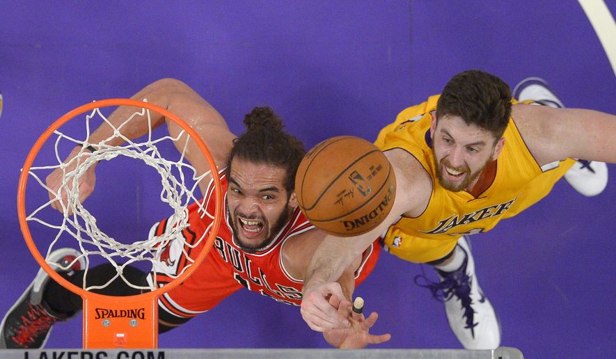 Chicago Bulls center Joakim Noah, left, and Los Angeles Lakers forward Ryan Kelly battle for a rebound during the second half of an NBA basketball game, Thursday, Jan. 29, 2015, in Los Angeles. The Lakers won 123-118 in double overtime. (AP Photo/Mark J. Terrill)