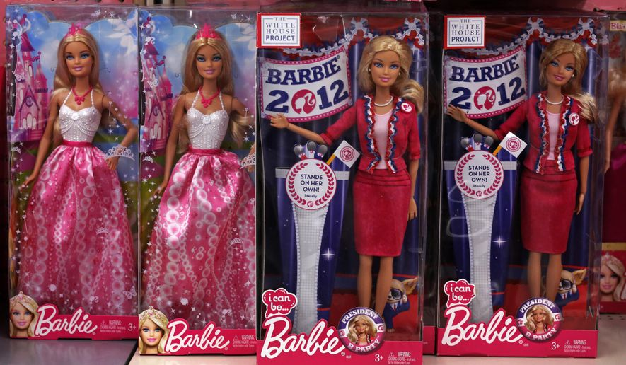 FILE - In this Tuesday, Jan. 28, 2014, file photo,  Barbie dolls, a Mattel product, are displayed in a Walmart store in Robinson Township, Pa. Mattel's fourth-quarter earnings released Friday Jan. 30, 2015 gave the first details on what contributed to a weak performance that led to the resignation of its chairman and CEO. Barbie sales fell 12 percent, though that wasn't as bad as the third quarter's 21 percent drop. (AP Photo/Gene J. Puskar, File)