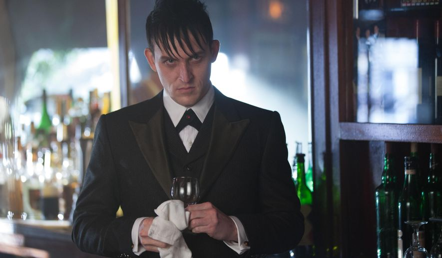 """In this image released by Fox, Robin Lord Taylor portrays Oswald Cobblepot in a scene from """"Gotham,"""" airing Mondays at 8 p.m. EST on Fox. (AP Photo/Fox, Jessica Miglio)"""
