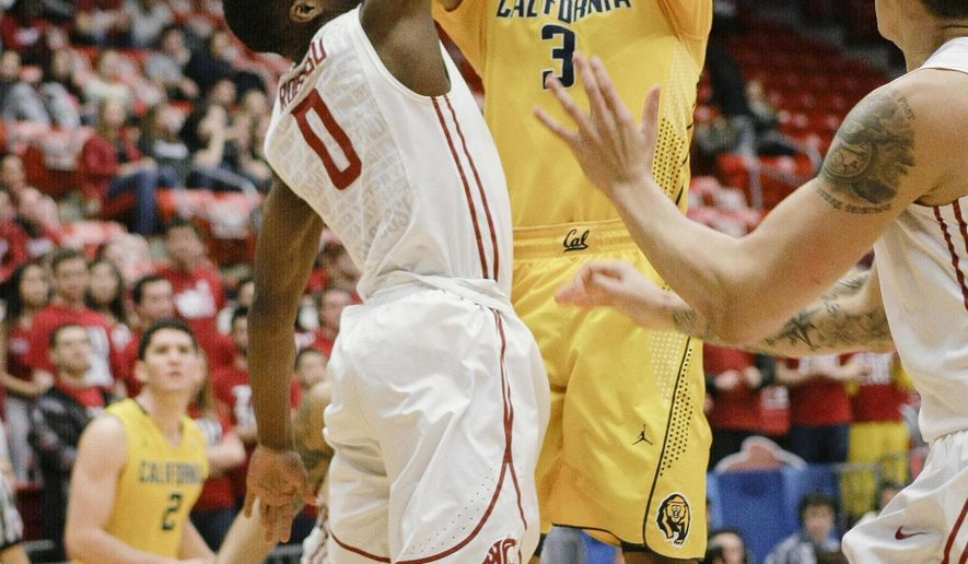 California guard Tyrone Wallace (3) hits a jumper over Washington State guard Ike Iroegbu during the first half of an NCAA college basketball game, Thursday, Jan. 29, 2015, in Pullman, Wash. (AP Photo/Gary Breedlove)