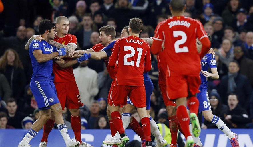 Liverpool's Steven Gerrard, third left, clashes with Chelsea's Diego Costa, left, during the English League Cup semifinal second leg soccer match between Chelsea and Liverpool at Stamford Bridge stadium in London, Tuesday, Jan. 27, 2015. (AP Photo/Kirsty Wigglesworth)