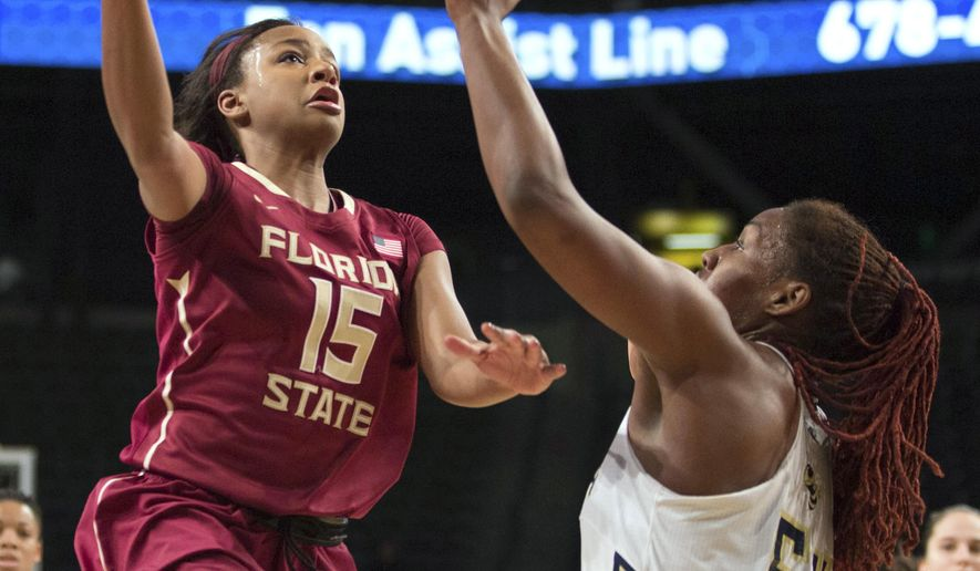 Florida State guard Maegan Conwright (15) drives to the basket against Georgia Tech's Roddreka Rogers during the first half of an NCAA college basketball game Friday, Jan. 30, 2015, in Atlanta. (AP Photo/Branden Camp)