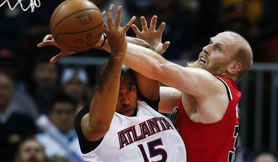 Portland Trail Blazers center Chris Kaman, right, and Atlanta Hawks center Al Horford vie for a rebound during the first half of an NBA basketball game Friday, Jan. 30, 2015, in Atlanta. (AP Photo/John Bazemore)