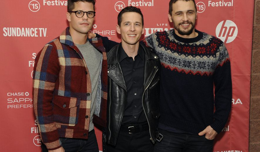 "Justin Kelly, center, director of ""I Am Michael,"" poses with cast members Charlie Carver, left, and James Franco at the premiere of the film at the Eccles Theatre during the 2015 Sundance Film Festival on Thursday, Jan. 29, 2015, in Park City, Utah. (Photo by Chris Pizzello/Invision/AP)"