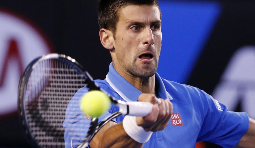 Novak Djokovic of Serbia makes a forehand return to Stan Wawrinka of Switzerland during their semifinal at the Australian Open tennis championship in Melbourne, Australia, Friday, Jan. 30, 2015. (AP Photo/Vincent Thian)