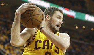 Cleveland Cavaliers' Kevin Love grabs a rebound against the Oklahoma City Thunder in the third quarter of an NBA basketball game Sunday, Jan. 25, 2015, in Cleveland. The Cavaliers won 108-98 to extend their winning streak to six games. (AP Photo/Mark Duncan)