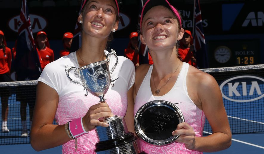 Tereza Mihalikova of Slovakia, left,  holds the trophy with runner-up Katie Swan of Britain after winning the junior girls' singles final at the Australian Open tennis championship in Melbourne, Australia, Saturday, Jan. 31, 2015. (AP Photo/Vincent Thian)