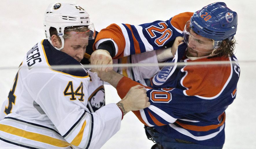Buffalo Sabres' Nicolas Deslauriers (44) and Edmonton Oilers' Luke Gazdic (20) fight during the third period of an NHL hockey game Thursday, Jan. 29, 2015, in Edmonton, Alberta. (AP Photo/The Canadian Press, Jason Franson)