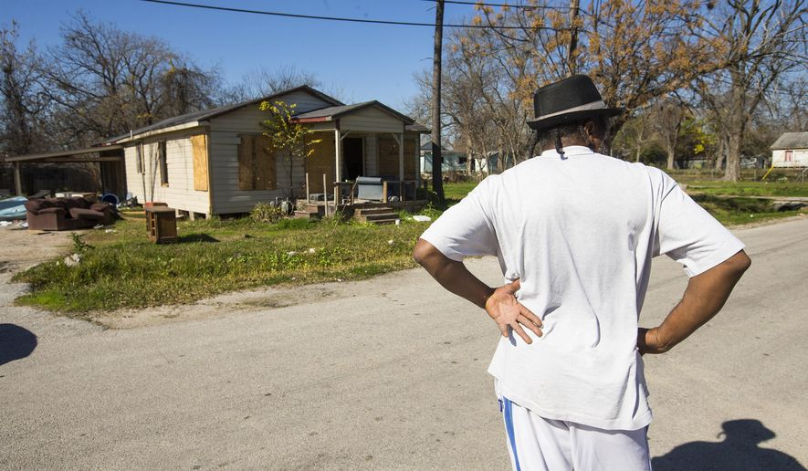 ADVANCE FOR MONDAY FEB. 2 AND THEREAFTER - In a Monday, Jan. 19, 2015 photo, an empty house in the 4200 block of Courtland stands in disrepair in old Studewood neighborhood next to Booker T. Washington High School, in Houston. The area was was once the first black municipality in Texas. (AP Photo/Houston Chronicle, Brett Coomer)