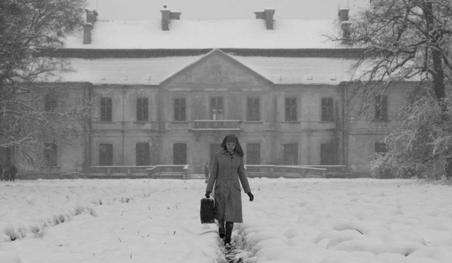 """This image released by Music Box Films shows Agata Trzebuchowska in a scene from """"Ida.""""  The film was nominated for an Oscar Award for best foreign feature on Thursday, Jan. 15, 2015. The 87th Annual Academy Awards will take place on Sunday, Feb. 22, 2015 at the Dolby Theatre in Los Angeles. (AP Photo/Music Box Films)"""