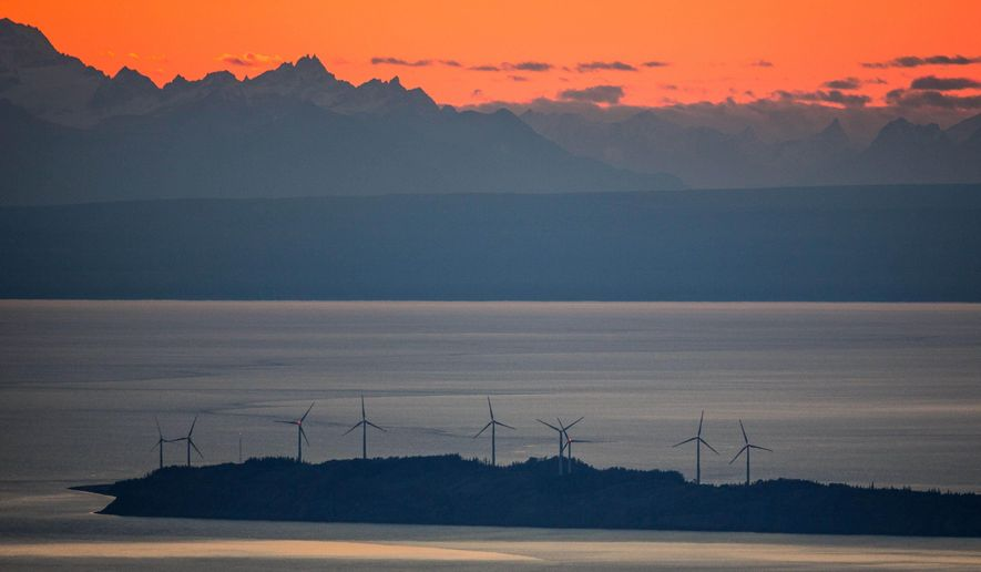 In this photo taken Sept. 24, 2014, wind turbines spin on Fire Island at sunset just off shore from Anchorage, Alaska. Plans to add turbines to the Fire Island Wind project were suspended this month when the project ran into a hitch: No one wants to buy the power. (AP Photo/Alaska Dispatch News, Loren Holmes)