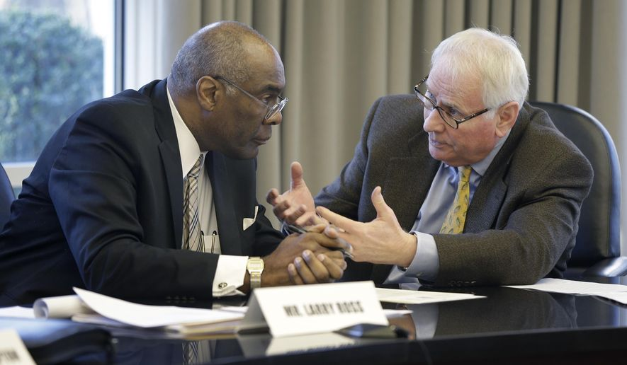 Larry Ross, chair of the Independent Citizens Commission, left, talks with Vice Chair Chuck Banks before a meeting in Little Rock, Ark., Friday, Jan. 30, 2015. The panel was set up to establish salaries for legislators and other elected officials. (AP Photo/Danny Johnston)