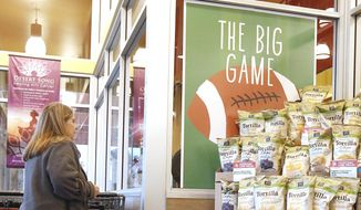 "So as not to infringe on the NFL Super Bowl name trademark, all non-rights holders have to use different wording to promote any Super Bowl activity like this Whole Foods grocery store where a customer passes a promotional display for ""the big game"" Wednesday, Jan. 28, 2015, in Phoenix. (AP Photo/Ross D. Franklin)  ** FILE **"