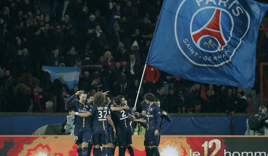 Paris St Germain players celebrate a goal during the French league one soccer match between Paris Saint Germain and Rennes, in Paris, France, Friday, Jan. 30, 2015. (AP Photo/Christophe Ena)