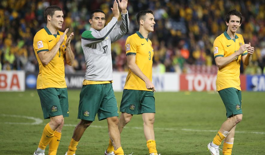From left to right, Australia's Mathew Leckie, Tim Cahill, Jason Davidson and Robbie Kruse acknowledge the crowd after winning the AFC Asian Cup semifinal soccer match between Australia and United Arab Emirates in Newcastle, Australia, Tuesday, Jan. 27, 2015. (AP Photo/Rick Rycroft)