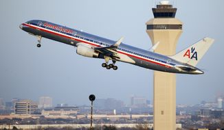 In this Jan. 15, 2015, photo, an American Airlines aircraft takes off from Dallas-Fort Worth International Airport, in Grapevine, Texas. (AP Photo/Tony Gutierrez) ** FILE **