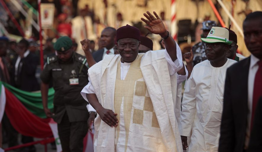 Nigerian President Goodluck Jonathan waves at supporters in Yola, Nigeria, Thursday, Jan. 29, 2015. (AP Photo/Lekan Oyekanmi)