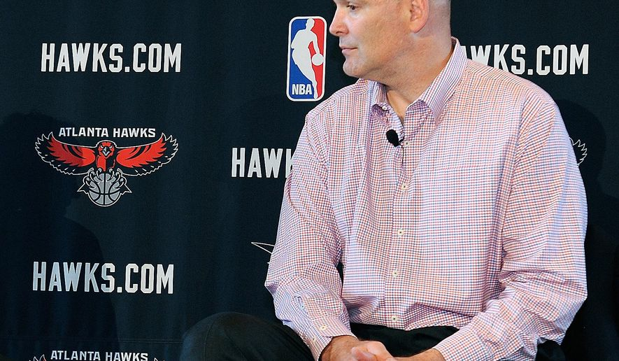 FILE - In this May 29, 2013, file photo, Atlanta Hawks general managerr Danny Ferry waits during a news conference in Atlanta.   Ferry can only watch from afar, perhaps taking some satisfaction that the team he put together is the biggest surprise in the NBA. Racially charged comments forced the Hawks general manager to take an indefinite leave, but maybe it's time to recognize that he's been punished enough. (AP Photo/David Tulis, File)
