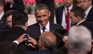 U.S. President Barack Obama interacts with the audience after delivering a speech at the Siri Fort Auditorium, a government-run event center, in New Delhi, India, Tuesday, Jan. 27, 2015. (AP Photo/Saurabh Das)