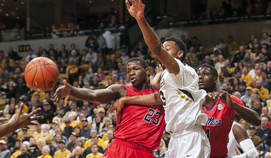 Missouri's Johnathan Williams III, center, battles Mississippi's Dwight Coleby, left, and Mississippi's M.J. Rhett, right, for a rebound during the first half of an NCAA college basketball game Saturday, Jan. 31, 2015, in Columbia, Mo. (AP Photo/L.G. Patterson)