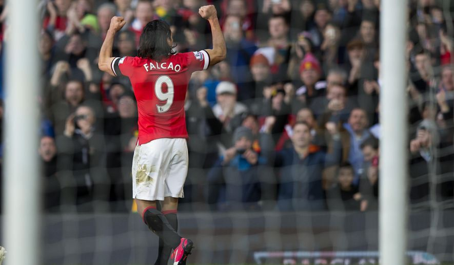 Manchester United's Radamel Falcao Garcia celebrates after scoring against Leicester during the English Premier League soccer match between Manchester United and Leicester at Old Trafford Stadium, Manchester, England, Saturday Jan. 31, 2015. (AP Photo/Jon Super)