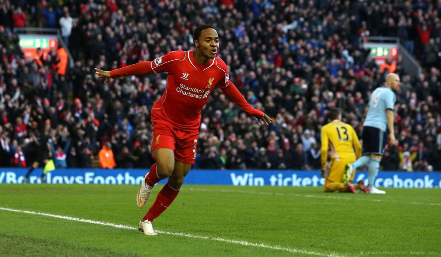 Liverpool's Raheem Sterling celebrates his goal against West Ham during the English Premier League soccer match at Anfield, Liverpool, England, Saturday, Jan. 31, 2015. (AP Photo/Peter Byrne, PA Wire)      UNITED KINGDOM OUT      -    NO SALES      -    NO ARCHIVES