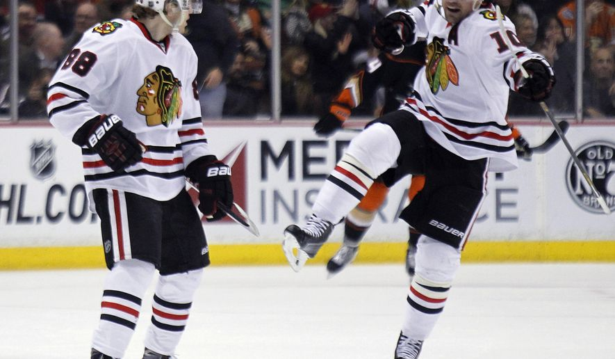 Chicago Blackhawks left wing Patrick Sharp (10) celebrates a goal by right wing Patrick Kane (88) during the second period of an NHL hockey game against the Anaheim Ducks in Anaheim, Calif., Friday, Jan. 30, 2015. (AP Photo/Alex Gallardo)
